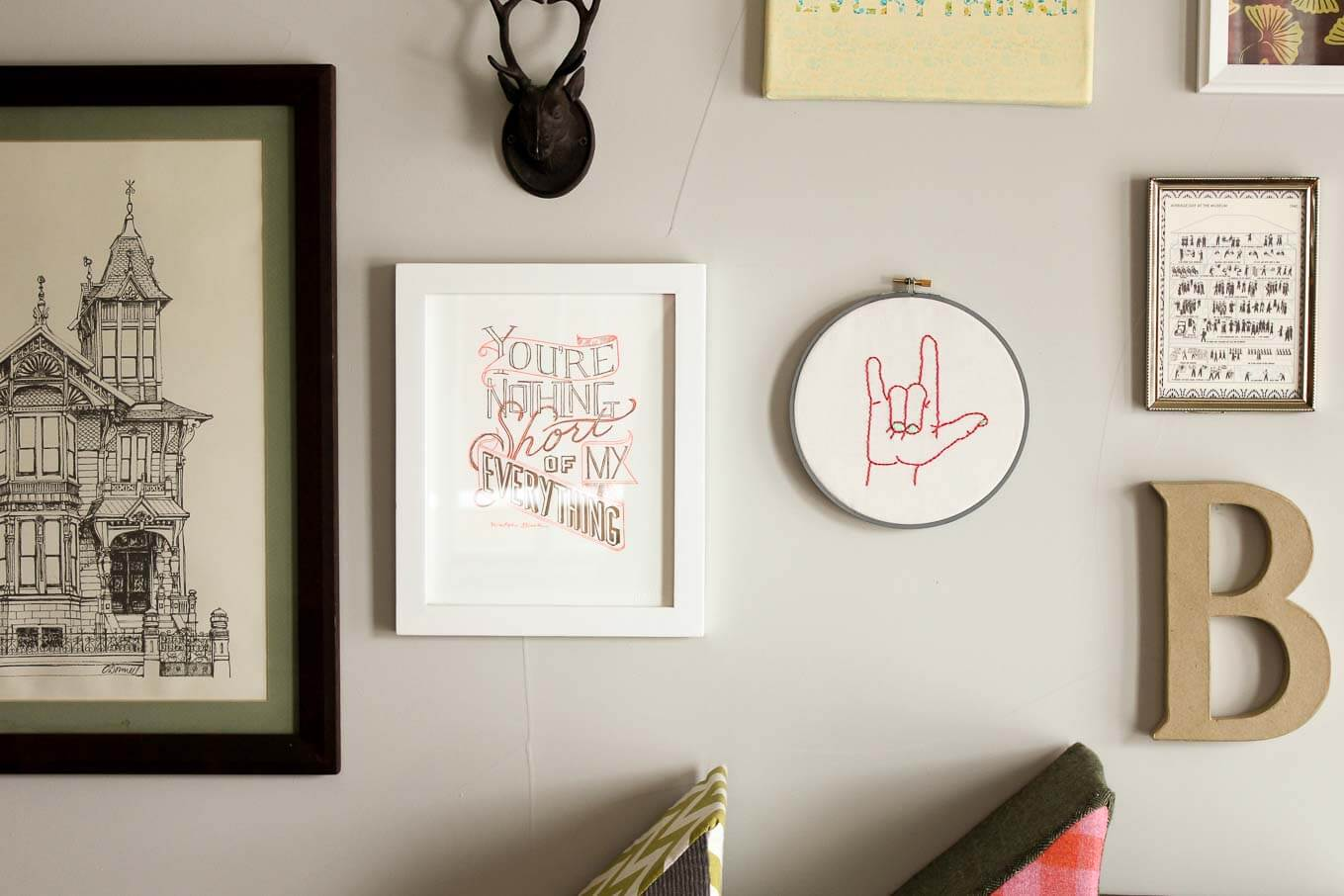 "This free embroidery pattern is based on the American Sign Language sign for ""I love you."" Perfect DIY art for a baby nursery, playroom or Valentine's Day gift idea. Download the design at MakeAndDoCrew.com."