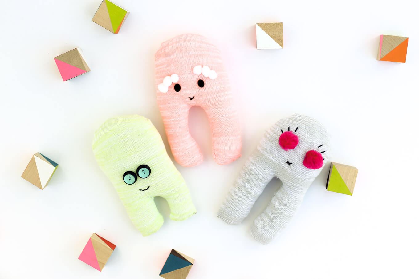 These easy sock robots are a perfect beginner sewing project because they only require a few basic hand sewing skills. Plus, they're a great activity to help teach kids how to sew. | MakeAndDoCrew.com
