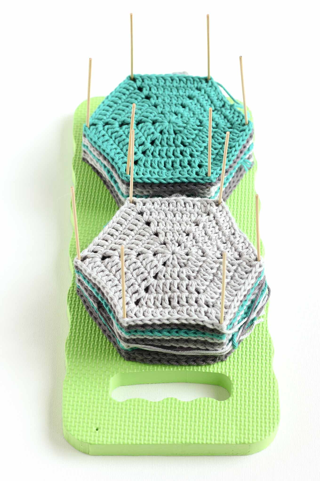 Learn how to block crochet or knit hexagons or granny squares with this incredibly easy and inexpensive DIY blocking board (made from a garden kneeling pad!) Click for full tutorial. | MakeAndDoCrew.com