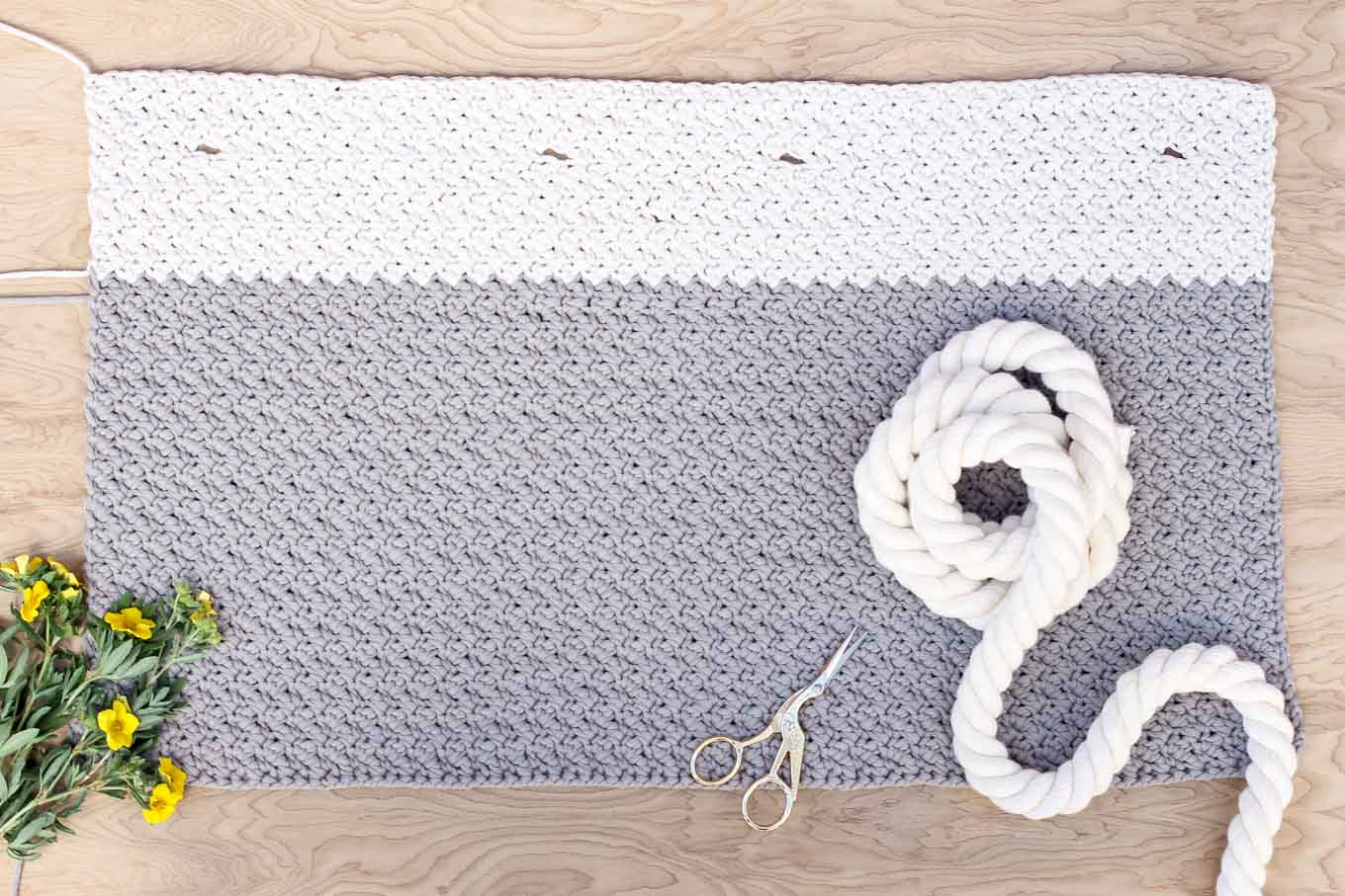 "This free crochet bag pattern for beginners is deceptively simple because it's made from one large rectangle. Neutral colors and a beautiful texture combine in the perfect modern tote or oversized purse. Click for the full ""Suzette"" stitch tutorial and free bag pattern. 