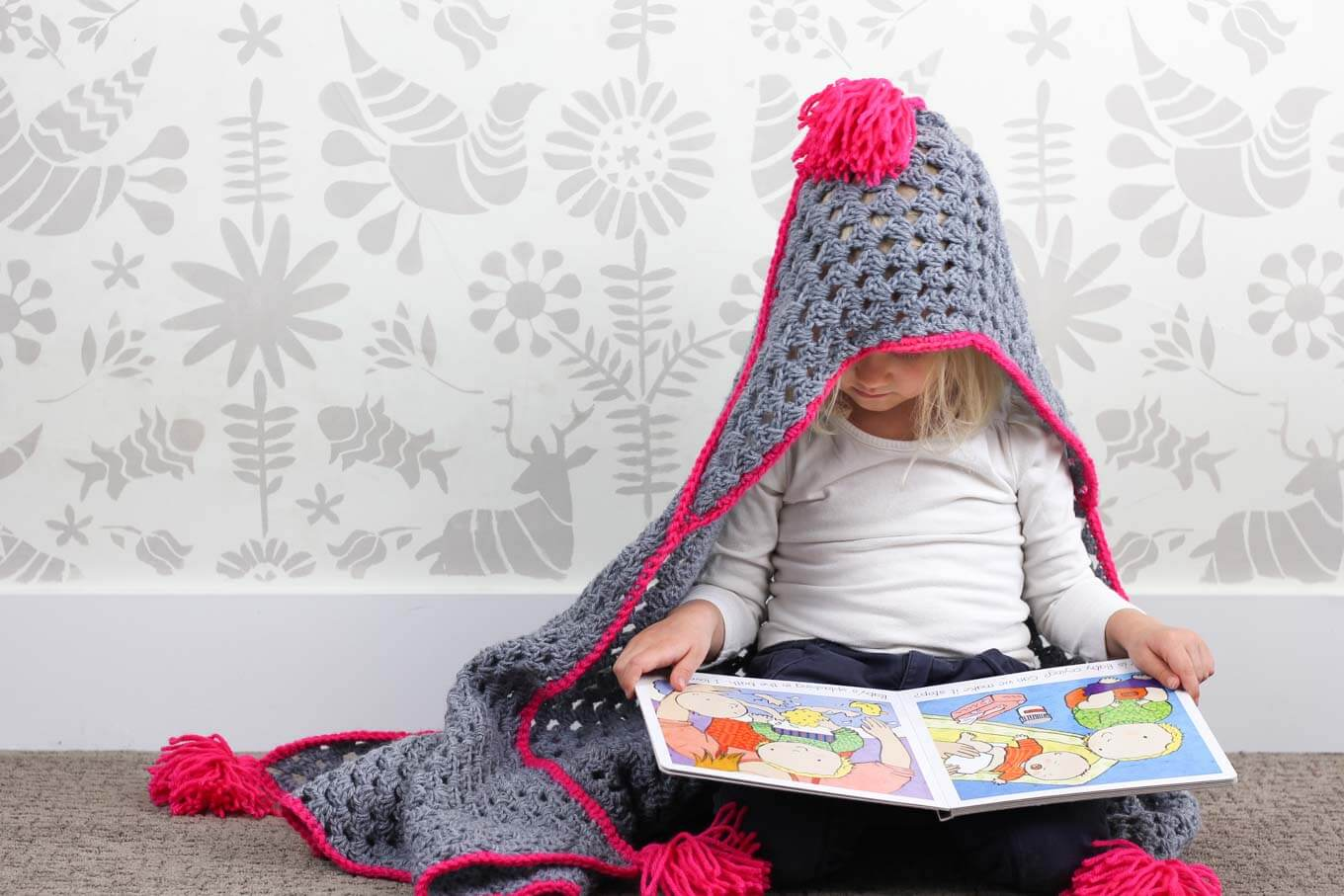"Based on a large granny square, the ""Granny Gives Back"" crochet hooded baby afghan pattern makes an easy and inexpensive project to donate to children's charities. The oversized hood and playful tassels will give any kid a safe, warm place to escape to. Click for the free pattern using Lion Brand Pound of Love yarn!"