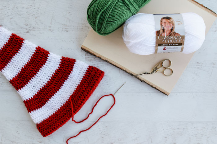 This free long tail crochet elf hat pattern with ears is made with Lion Brand Vanna's Choice yarn.