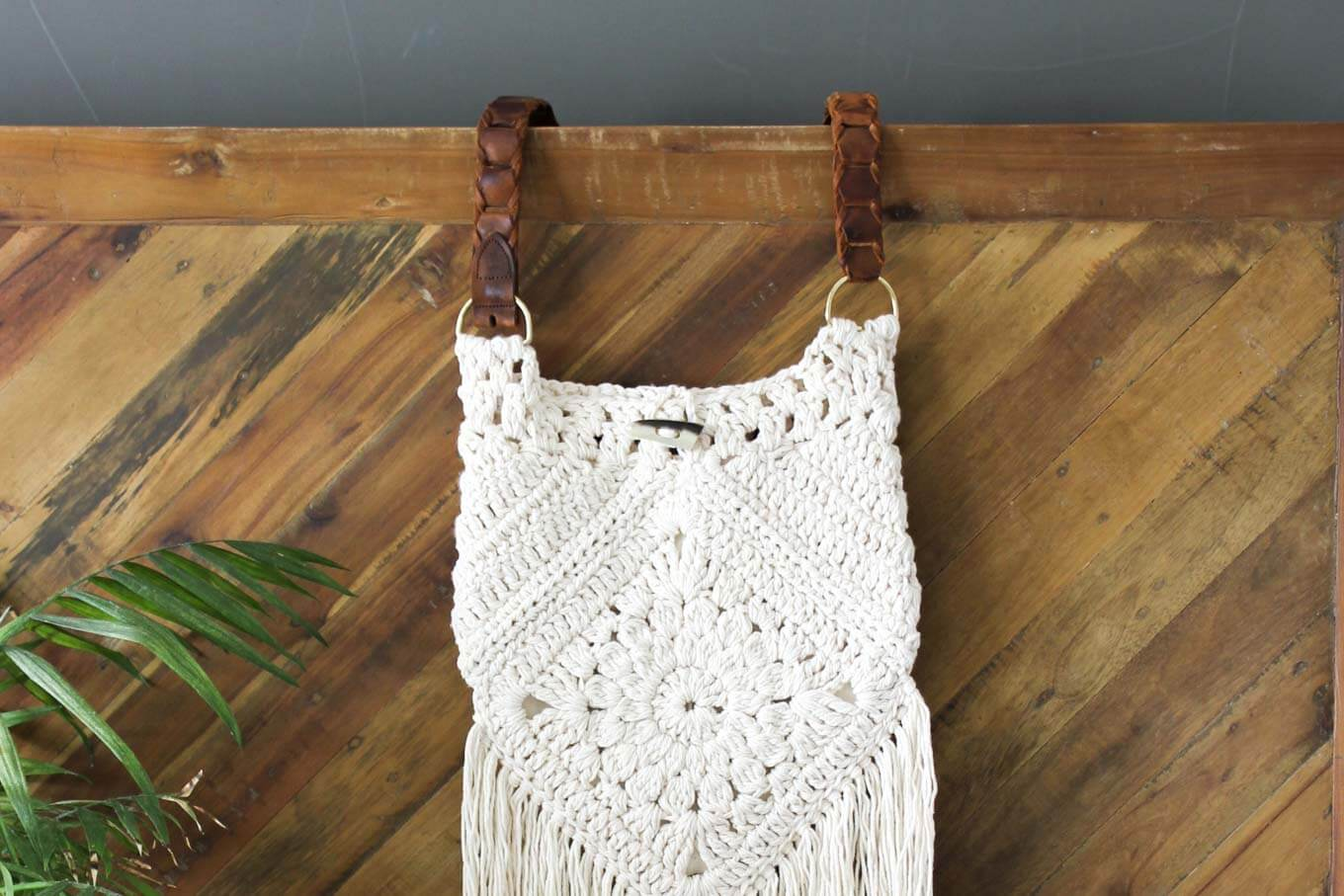 "Boho love! This free boho crochet purse pattern is fun to put together and loaded with bohemian charm. Made with Lion Brand Kitchen Cotton in ""Vanilla."""