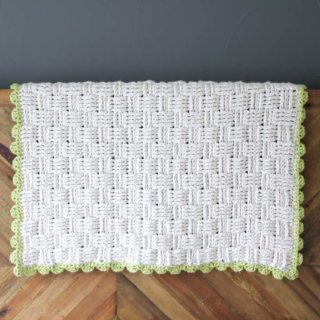 "Squishy yarn heaven! This free crochet basket weave blanket pattern is blooming with texture and makes a perfect baby playmat. Made with Lion Brand Wool-Ease Thick & Quick in ""Fisherman"" and Hometown USA in ""Monteray Bay."" 