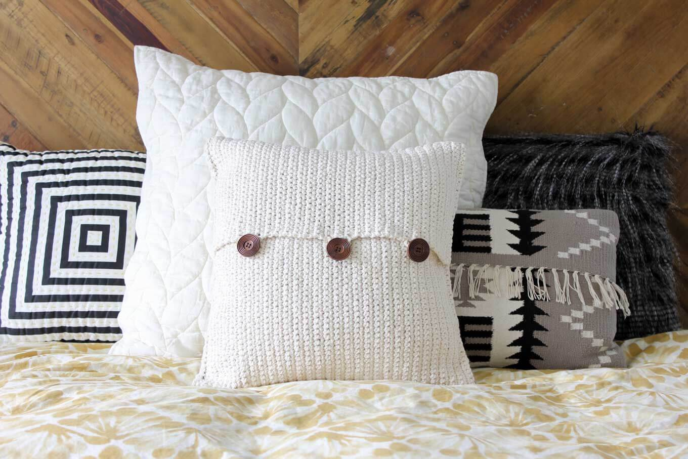 Beginner crochet pattern. Modern mudcloth pillow with button closures. Make and Do Crew.