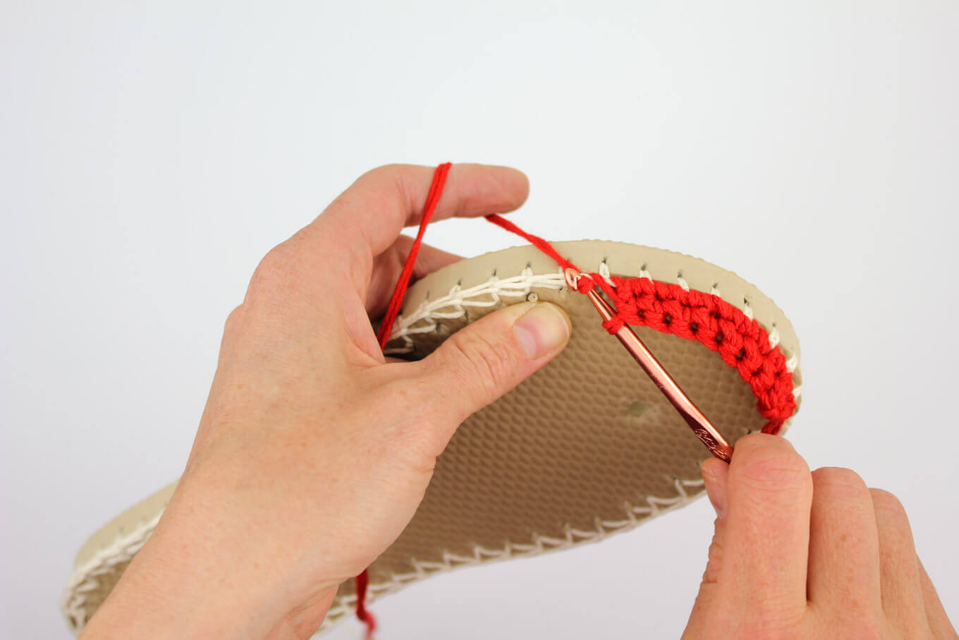 "Lion Brand 24/7 Cotton in ""Red"" used to make the toe of a crochet espadrilles shoe."