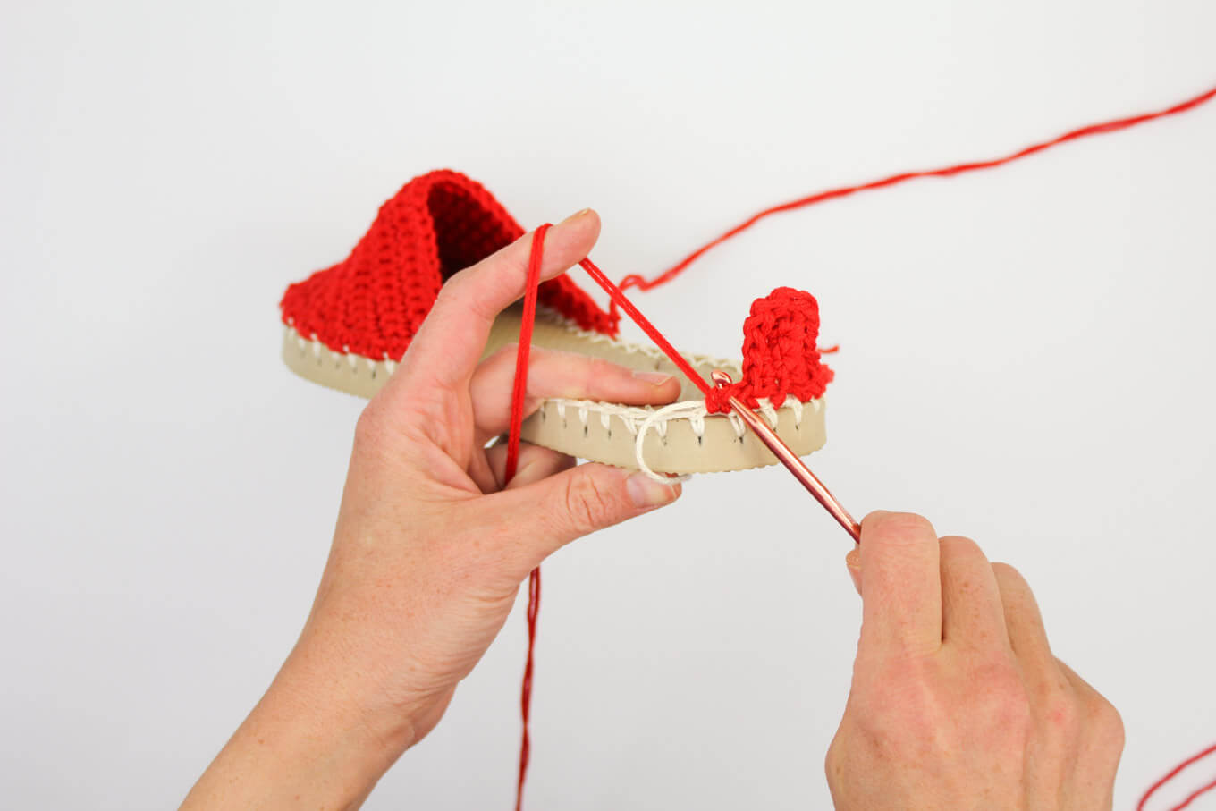"Learn how to make crochet espadrilles with flip flop soles in this free pattern and tutorial from Make and Do Crew! These crochet sandals feature Lion Brand 24/7 Cotton in ""Red."""