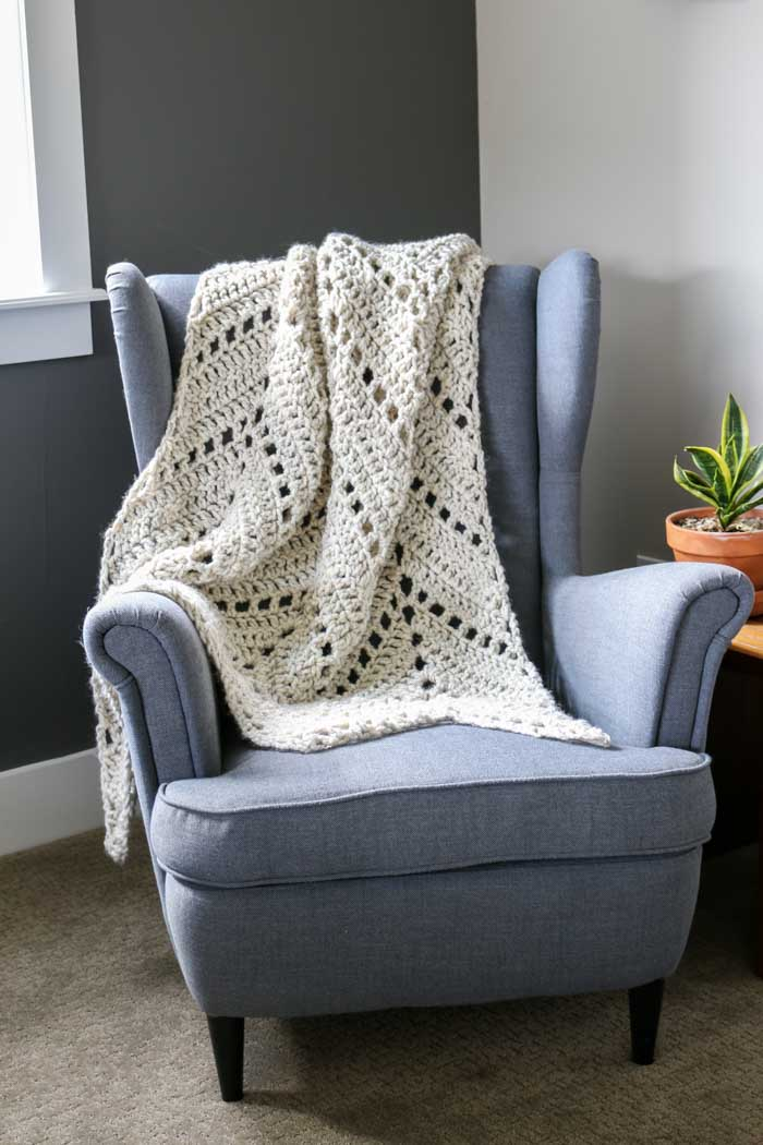 "This easy crochet ripple blanket free pattern is easy and fast, making it the perfect afghan or throw blanket for winter. Lion Brand Wool-Ease in ""wheat"" pictured."