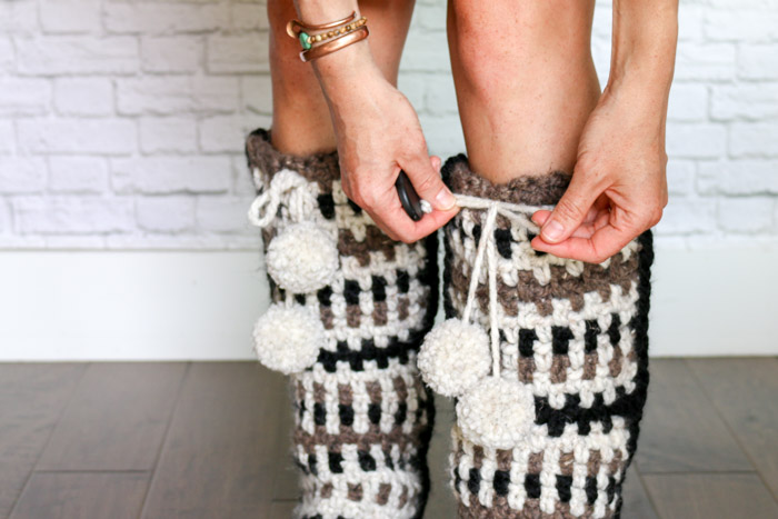 How to add pom poms to crochet projects. These make the perfect accent on crochet slippers!