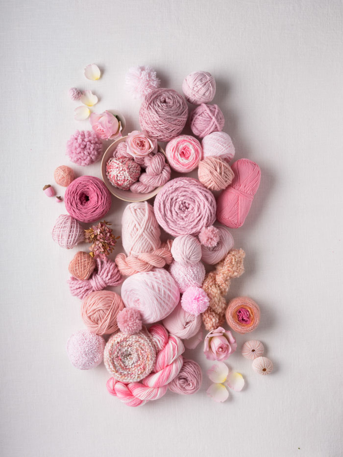 A beautiful collection of Lion Brand yarns in varying shades of pink, mauve, rose and antique.