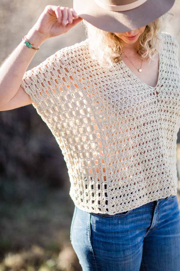 Lacy boho poncho-style crochet top that's perfect for spring or summer. Very simple construction that's easy for beginners. Featuring Lion Brand LB Collection Cotton Bamboo.