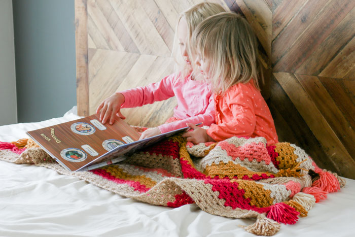 Free pattern for a child's granny stitch crochet afghan pattern featuring Lion Brand Heartland yarn. Love the tassels!