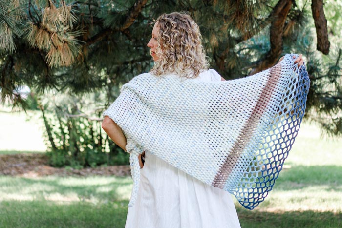 This easy asymmetrical crochet shawl pattern is made from simple puff stitches and lace. Free pattern featuring Lion Brand Ice Cream and Mandala yarn.