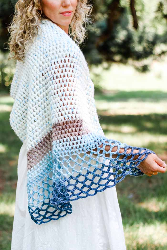 This elegant asymmetrical crochet triangle shawl pattern is simple to follow and fun to wear year round. Perfect for wearing to the beach, a summer wedding or even during the winter.