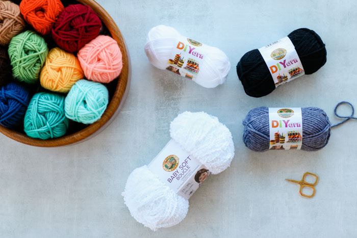 Lion Brand Baby Soft Boucle Yarn in white and DIYarn, which is the best yarn for crochet amigurumi.