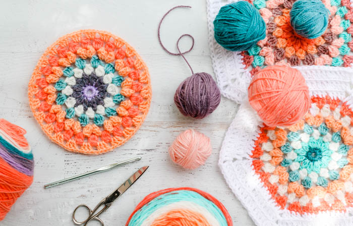 Free crochet hexagon blanket pattern + video tutorial including instructions for making a half hexagon. Featuring Lion Brand Mandala, Cupcake and Pound of Love yarns.
