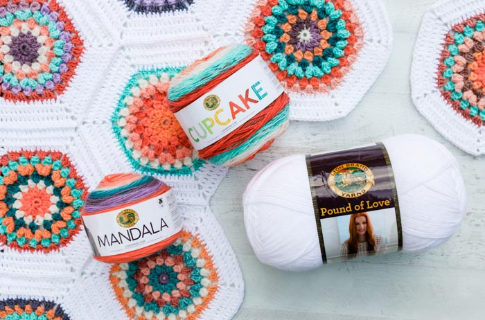 Use Lion Brand Mandala cake yarn or yarn scraps to make this vintage-inspired crochet hexagon blanket. Customize to any size you wish! Free pattern + video tutorial using Lion Brand Mandala, Cupcake and Pound of Love yarn.