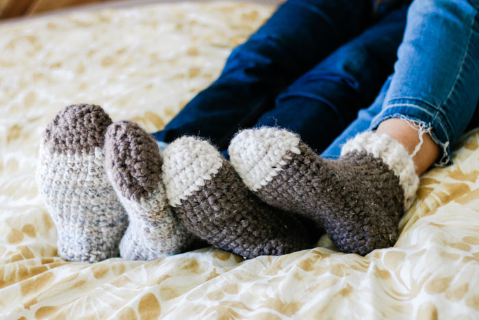 Crochet slipper socks free pattern for adult men and women using Lion Brand Wool-Ease Thick & Quick.