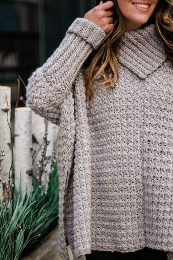 "Free crochet poncho pattern with sleeves featuring the sedge crochet stitch. Made using Lion Brand Touch of Alpaca yarn in ""Taupe."""
