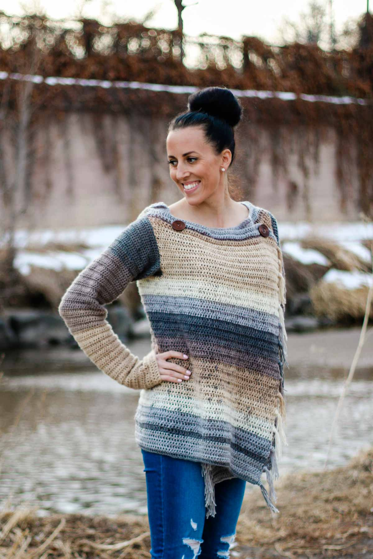 This crochet blanket sweater can button in front to create the look of a pullover or be worn open like a cardigan. Free pattern and tutorial.