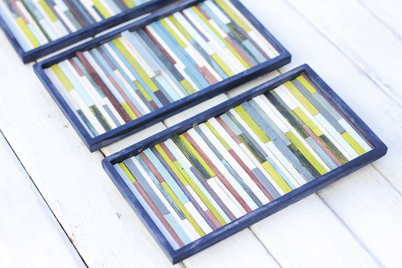 Make this DIY wall art idea for less than $7 using coffee stirrers. This reclaimed-wood-inspired look is super easy to achieve and adds a lot of texture to any wall. This is a craft anyone can make! Click for full how to tutorial. | MakeAndDoCrew.com