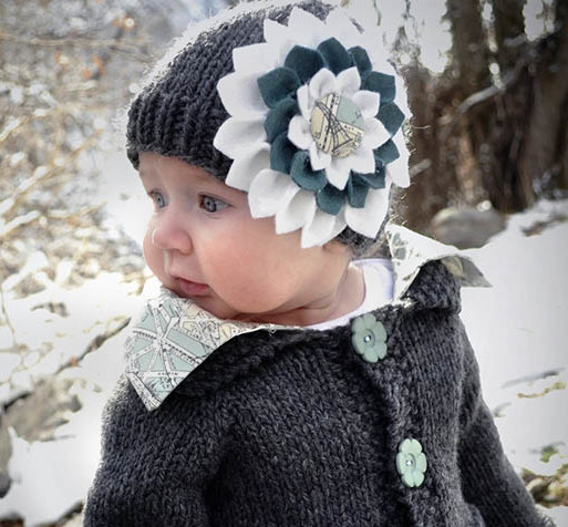 Tutorial to make a DIY felt flower--perfect for accenting a baby hat or headband. | MakeAndDoCrew.com