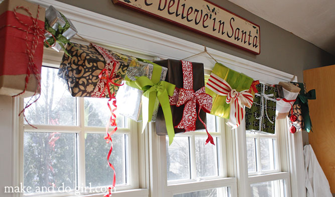 DIY Christmas decor idea--simple wrapped present garland. Inexpensive and so festive!