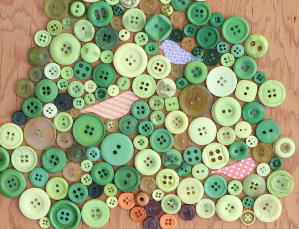 This DIY button art project looks great in a baby's room or nursery, especially as part of a gallery wall. Free printable template to make your own. Click for the full tutorial. | MakeAndDoCrew.com