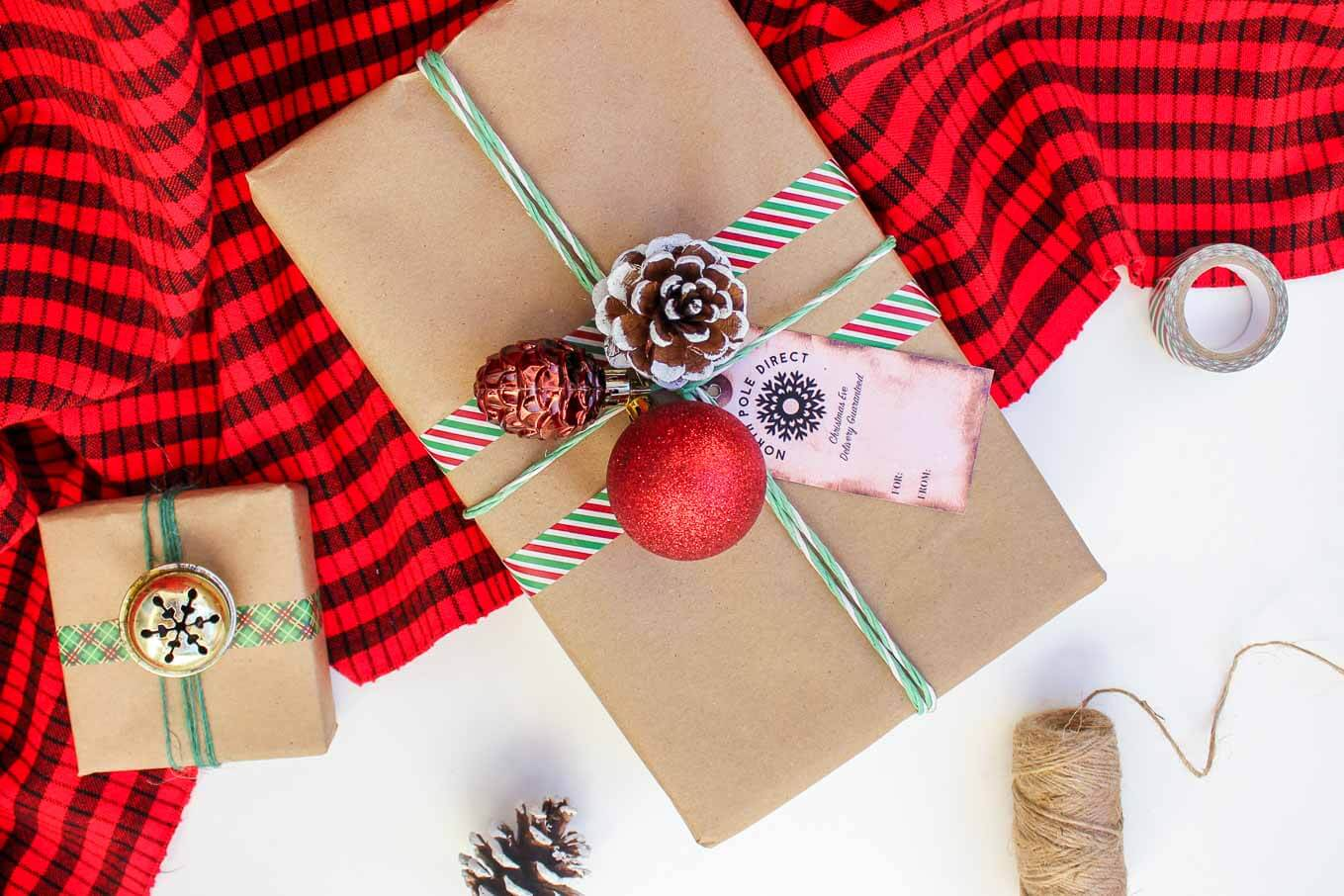 Christmas DIY gift wrap ideas with supplies from the dollar store. These gift topper ideas are sophisticated, festive and cheap! Click to see full tutorial. | MakeAndDoCrew.com