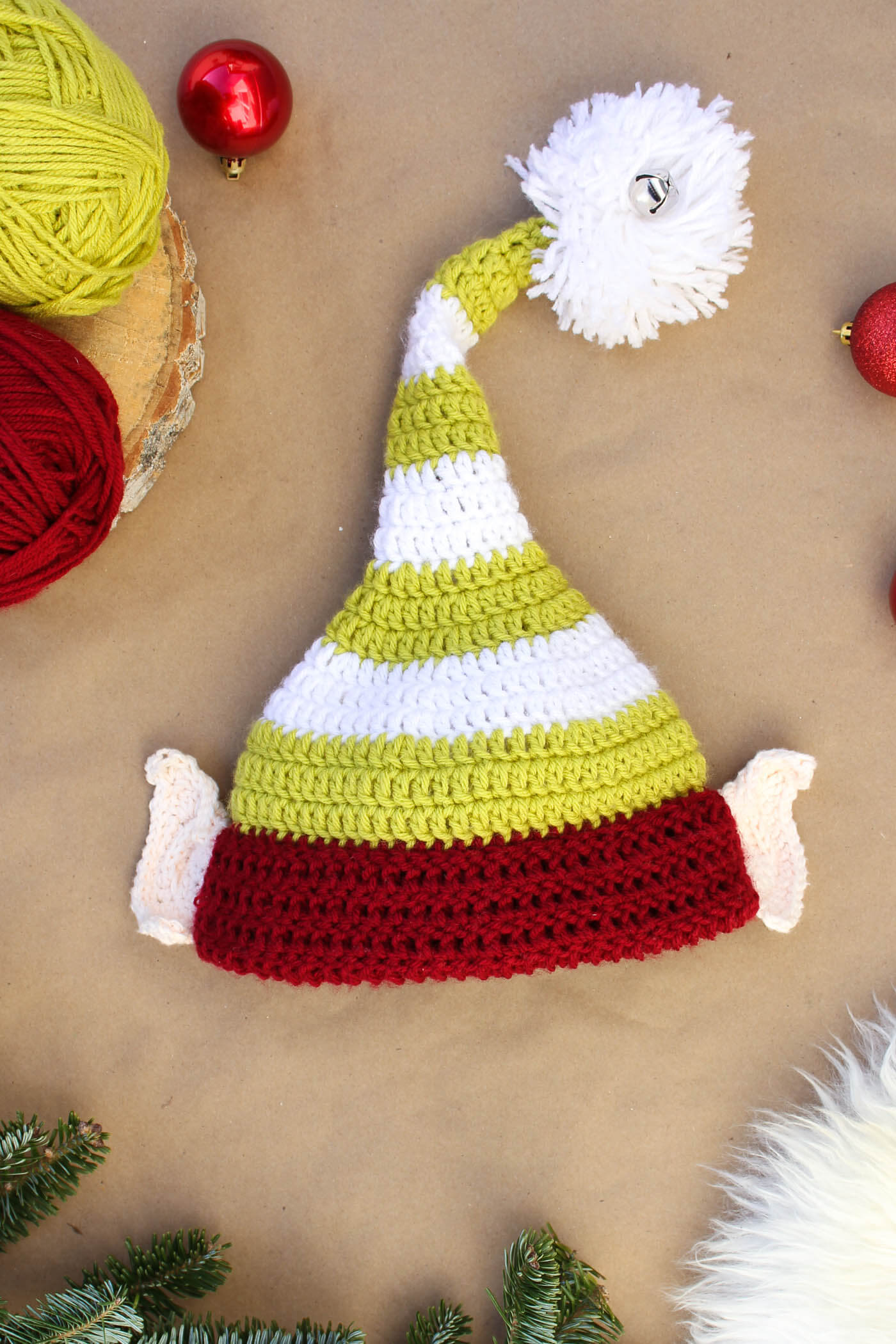 Free crochet elf hat pattern with ears! Make one for each member of the family. Perfect Christmas photo prop idea. Free pattern sizes include 0-3 months (newboarn), 3-6 months (baby), 6-12 months, toddler/preschooler, child and adult. Click to see full pattern. | MakeAndDoCrew.com