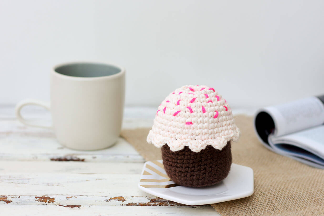 This free amigurumi crochet cupcake pattern makes a perfect DIY gift idea for a toddler or child. The birthday candle adds even more possibilities for play to this sweet toy. Or make it for a friend or co-worker when you need a calorie-free birthday gift! | MakeAndDoCrew.com
