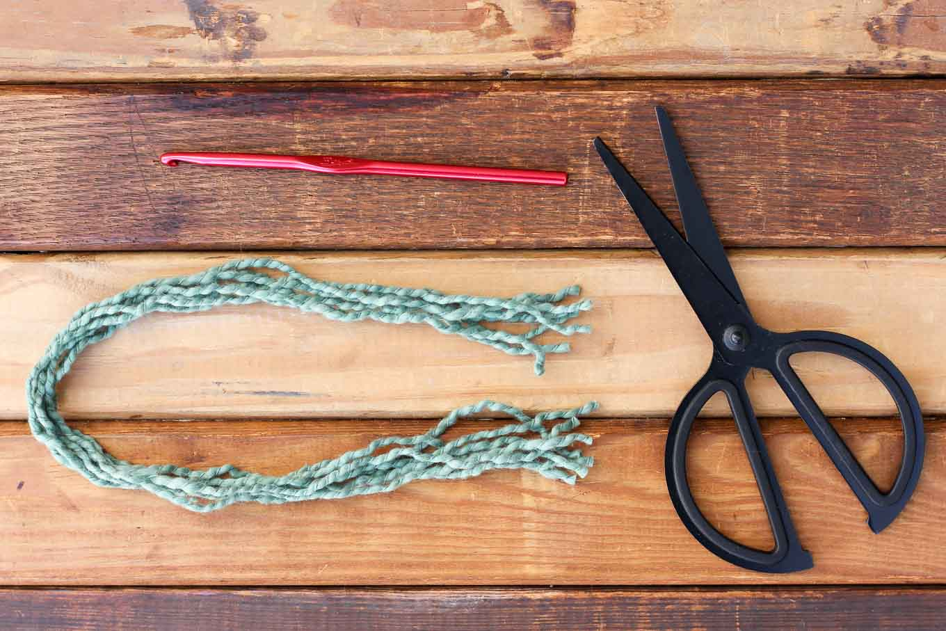 How to add braided straps to a crochet or knit hat. | MakeAndDoCrew.com