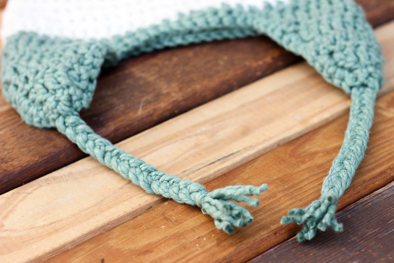 How to add braided straps to a crochet or knit beanie hat. | MakeAndDoCrew.com