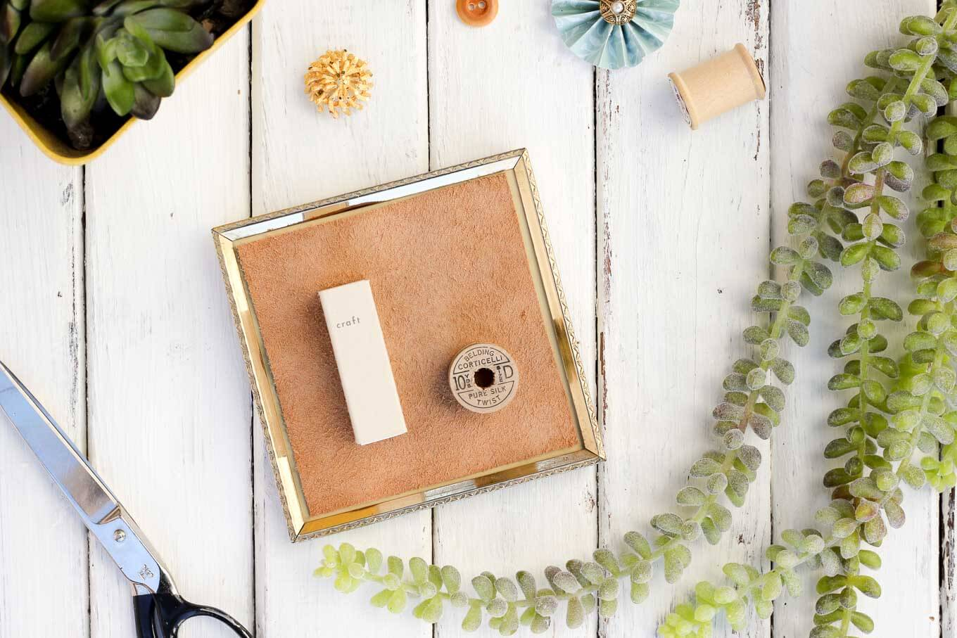 Anything can become a DIY wall decor idea with a little glue and creativity. This matchbook and vintage spool add charming dimension to the gallery wall in this craft room. And this DIY art cost less than a dollar to make! Click to view the tutorial.   MakeAndDoCrew.com