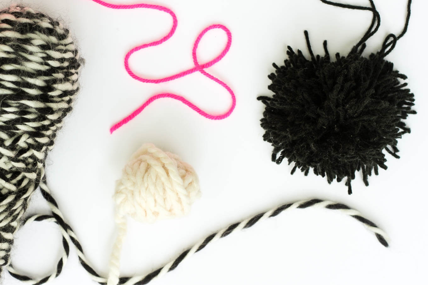 How to make a pom pom rug! This soft, scrumptiously squishy DIY pom pom rug takes very few skills to create and is a great way to use up a bunch of scrap yarn! Click for full tutorial. | MakeAndDoCrew.com