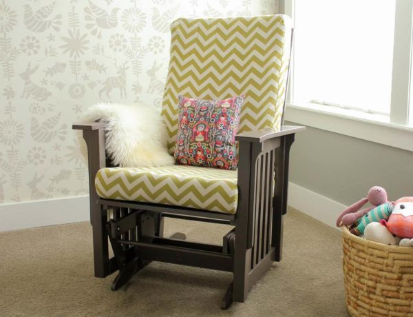 Super thorough tutorial on how to recover a glider chair for a baby's nursery. Instructions on sewing replacement slipcovers and painting the chair. Click to learn how to DIY your own glider makeover.   MakeAndDoCrew.com