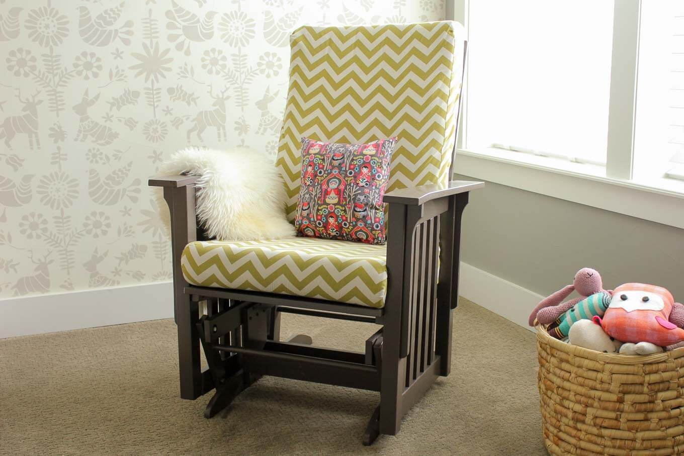 Super thorough tutorial on how to recover a glider chair for a baby's nursery. Instructions on sewing replacement slipcovers and painting the chair. Click to learn how to DIY your own glider makeover. | MakeAndDoCrew.com