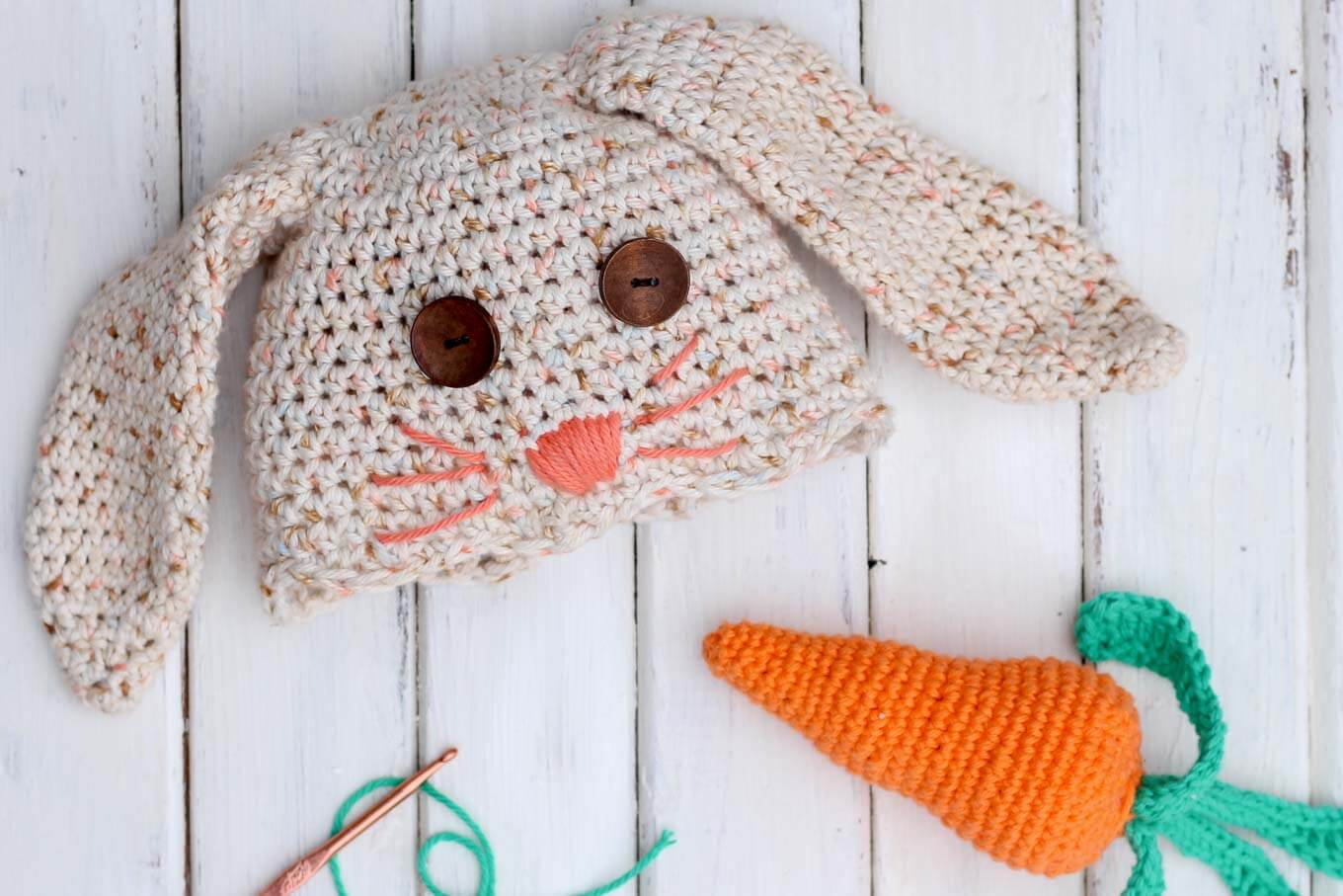 This crochet bunny hat and carrot toy make a great DIY baby shower gift idea or Easter surprise! | MakeAndDoCrew.com