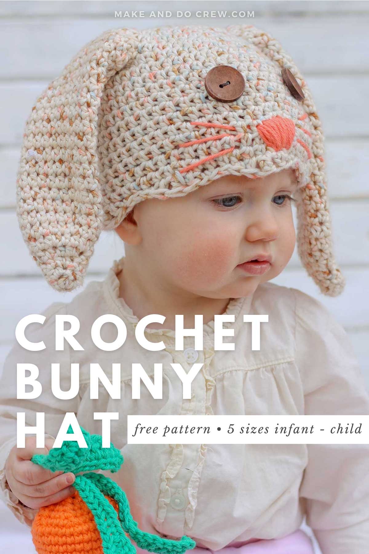 A chubby-cheeked baby wearing a crochet bunny hat complete with button eyes and sweet whiskers.