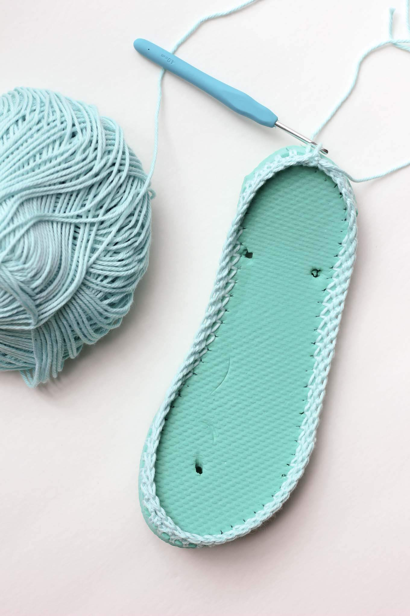 Cotton yarn and flip flops combine to make super comfy crochet slippers with soles in this free crochet pattern! These are perfect for warmer weather too!