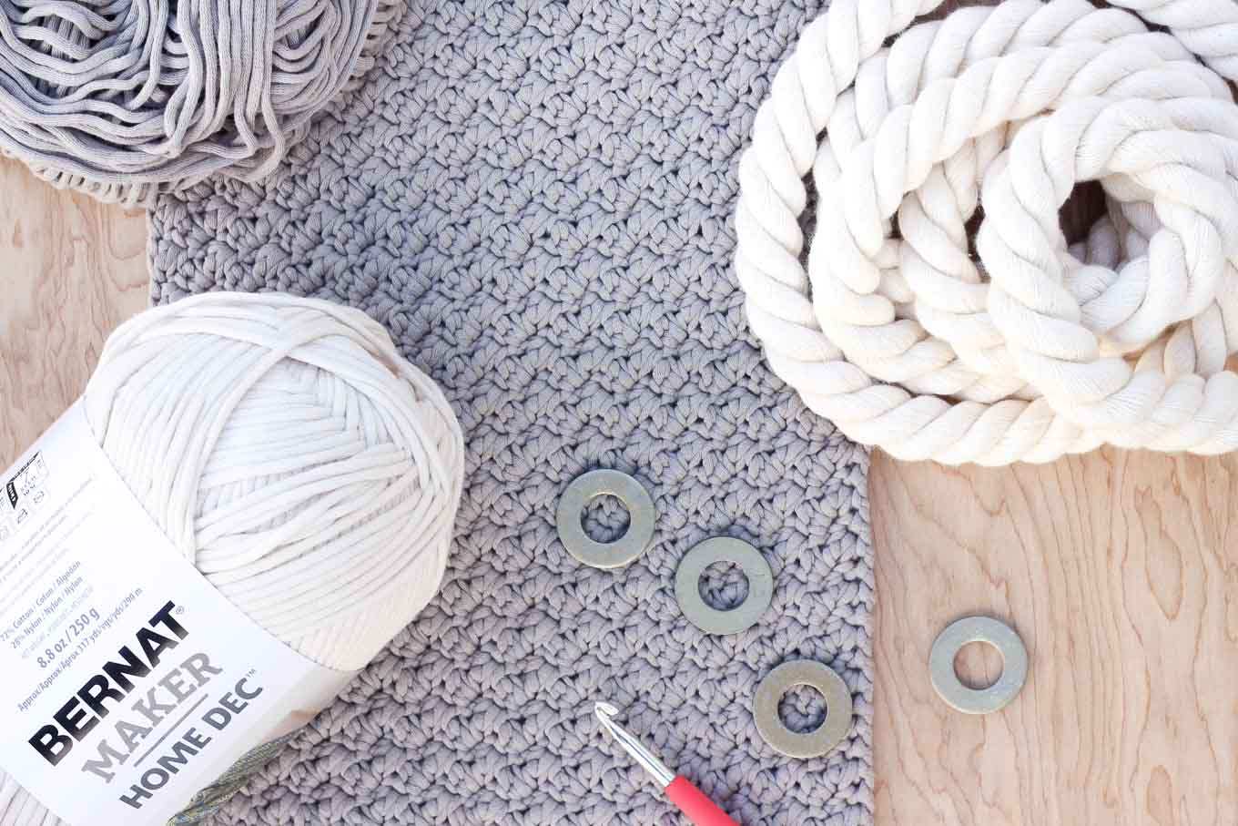 "This free crochet bag pattern for beginners is deceptively simple. Neutral colors and a beautiful texture combine in the perfect modern tote or oversized purse. Click for the full ""Suzette"" stitch tutorial and free bag pattern using Bernat Maker Home Dec yarn. 