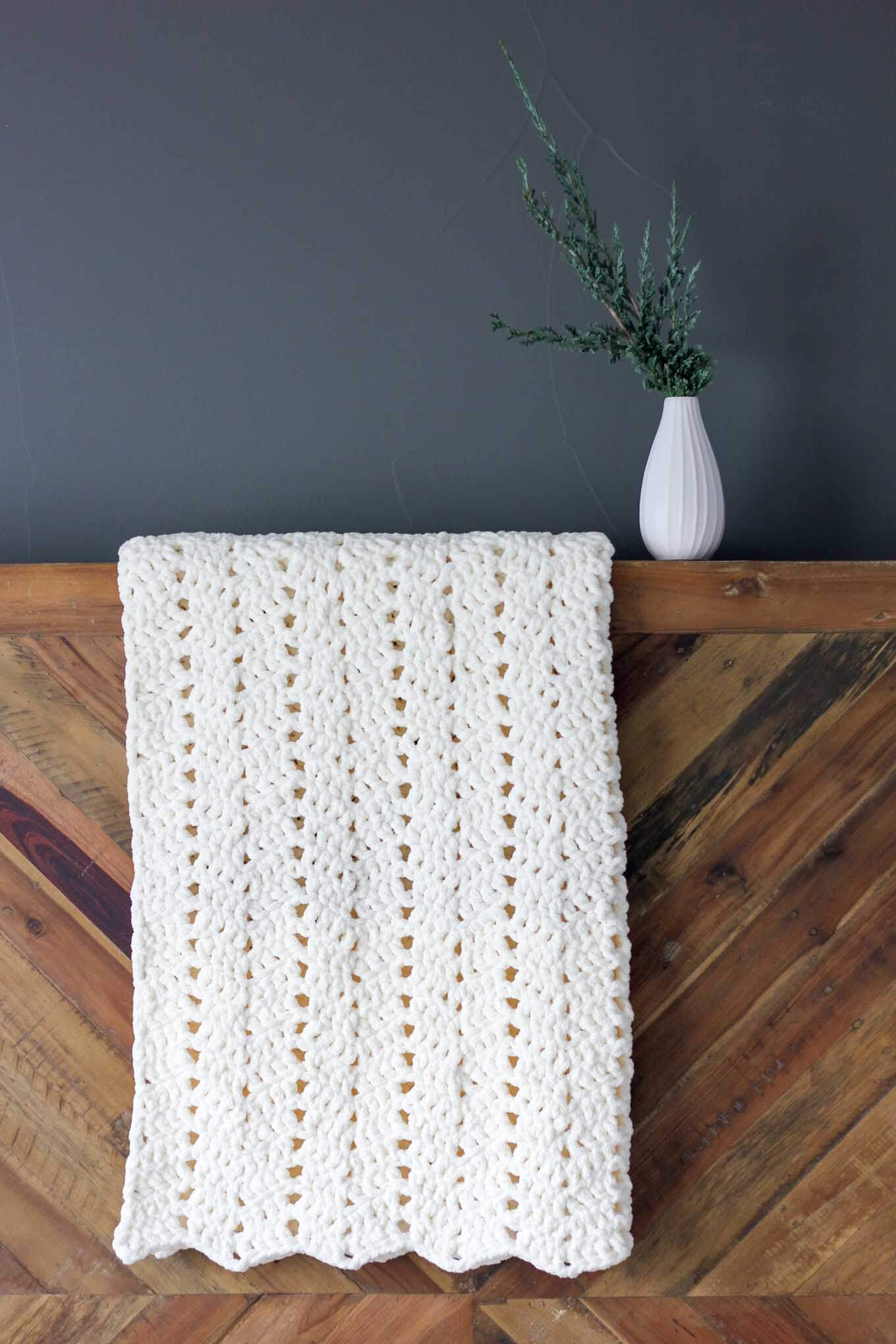 This chunky crochet blanket pattern makes a perfect timeless baby gift, but once you feel how soft it is, there's no way you won't want to make one for yourself too! The pattern explains how to make larger sizes and it works up super quickly in Bernat Blanket Yarn.
