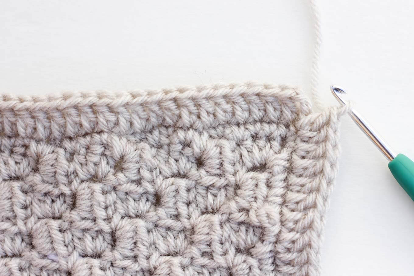 You've worked diligently on creating corner-to-corner crochet squares and now you're wondering what to do with them, right? This tutorial will show you how to add a border (or basic edging) to a C2C afghan block so that it's ready to be sewn together into a blanket.