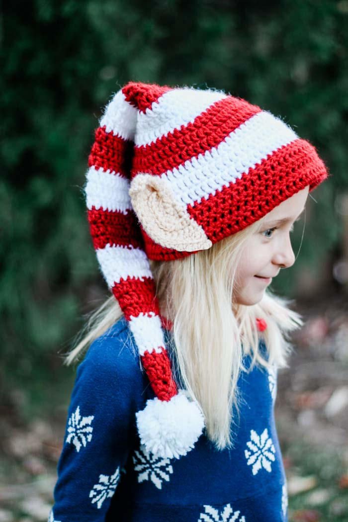 This free crochet elf hat pattern with ears is worked in the round and makes a fast crochet Christmas gift idea for babies, kids and adults!