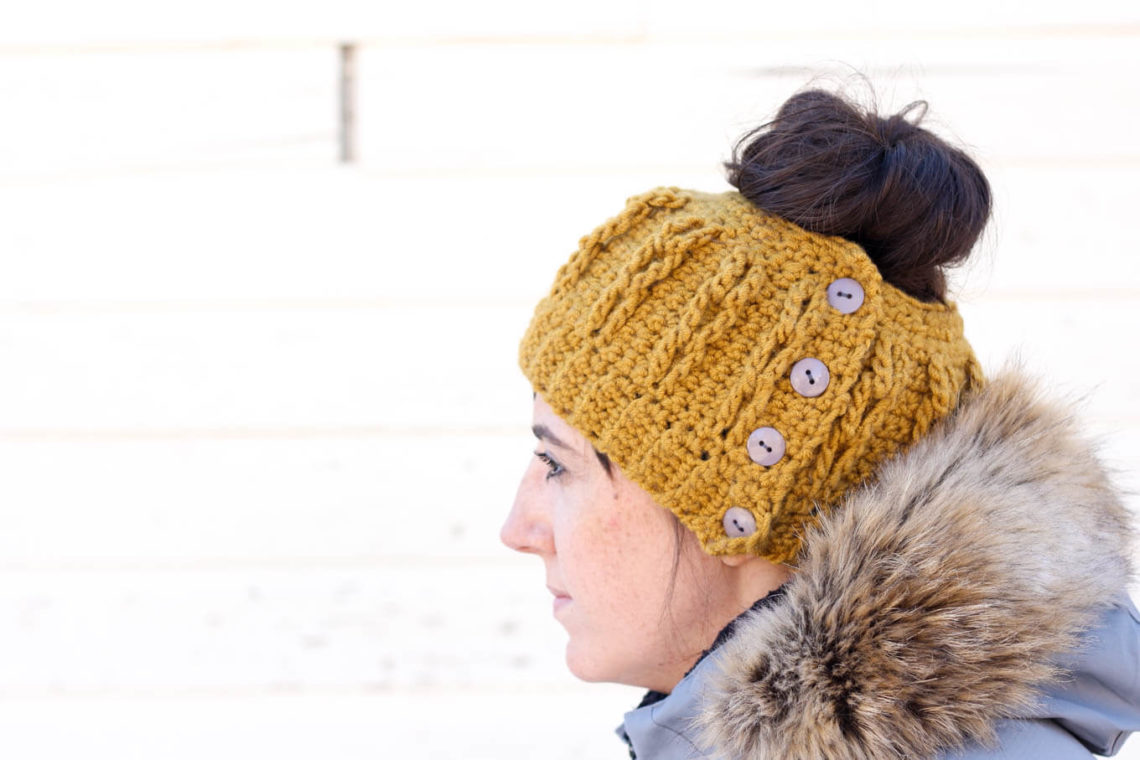 "Free crochet hat pattern with a hole in the top for your bun or ponytail to poke through. (AKA a ""bun beanie"" or ""ponytail hat"")"