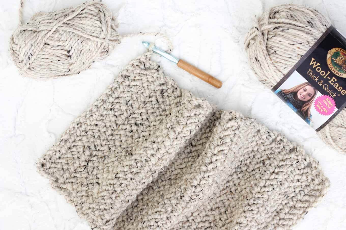 "A free crochet cowl pattern using chunky yarn and the herrringbone double crochet stitch. Yarn is Lion Brand Wool-Ease Thick & Quick in ""Oatmeal."""