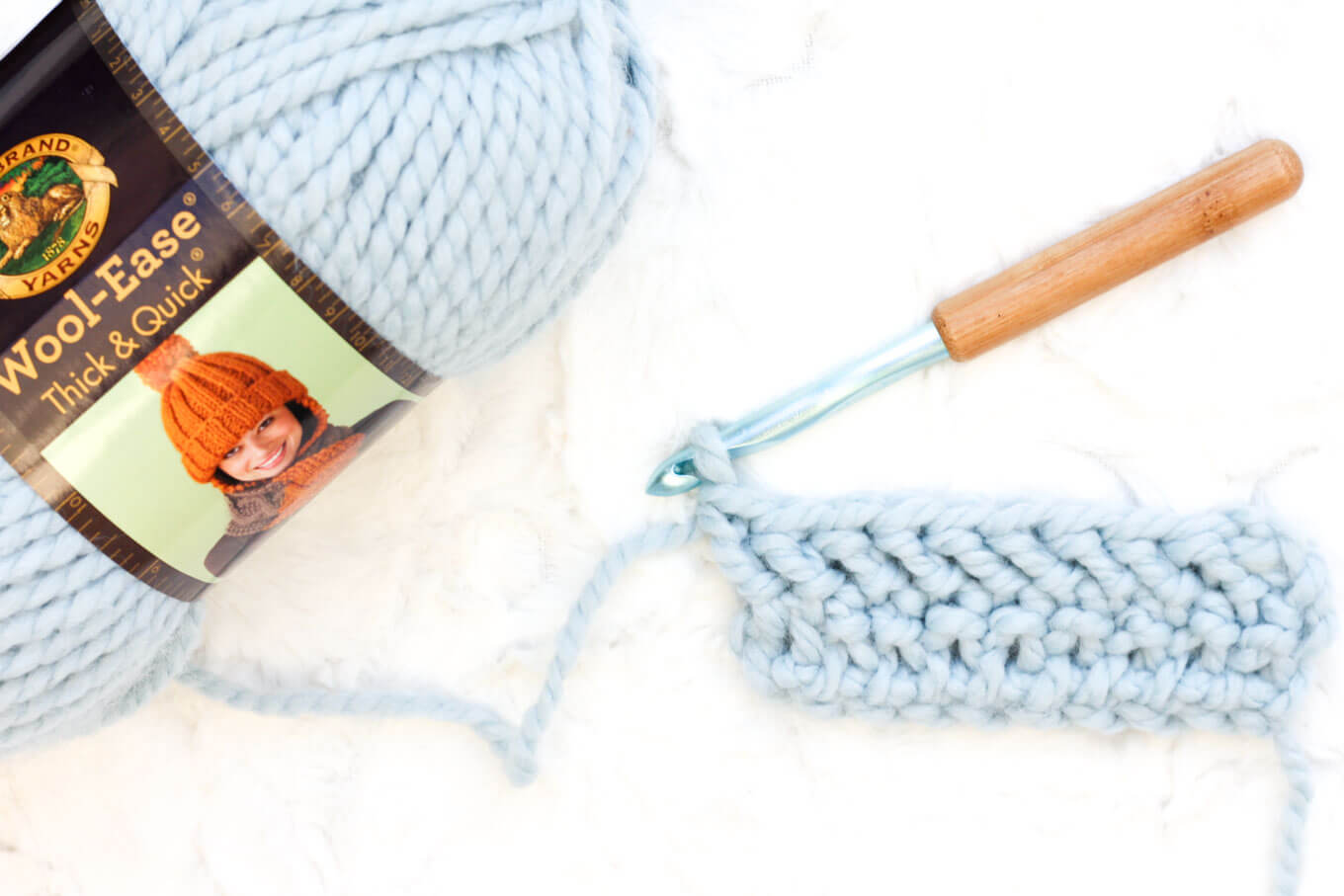 Learn how to crochet the herringbone double crochet stitch in this easy video tutorial. This modern-looking stitch is great for afghans, scarves and striped projects. Because it's based on double crochet, it also worked up really quickly! Lion Brand Thick and Quick pictured.