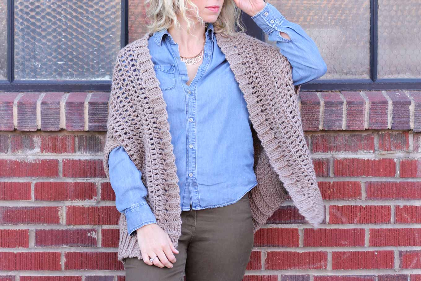 "You'd never guess by looking at this sweater that it's made from two simple rectangles! The ""Cocoon Cardigan"" free crochet pattern is great for beginners who are looking to expand their skills or advanced crocheters who want a quick, stylish project. Made with Lion Brand Lion's Pride Woolspun yarn in ""Taupe."""
