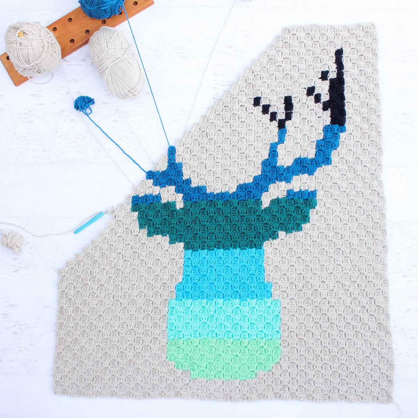 Hello ombre! This corner to corner crochet deer buck afghan will be a hit with your favorite baby, hipster or hunter! Download the free ombre deer c2c graph to make a baby blanket or larger throw. Made with Lion Brand Vanna's Choice yarn. | MakeAndDoCrew.com