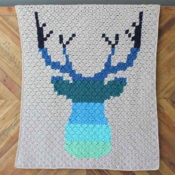 Hello ombre! This corner to corner crochet deer afghan will be a hit with your favorite baby, hipster or hunter! Download the free ombre deer c2c graph to make a baby blanket or larger throw. Made with Lion Brand Vanna's Choice yarn. | MakeAndDoCrew.com